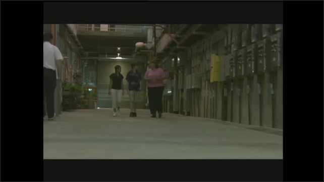 1990s: Woman and kids walk through building, woman talks.