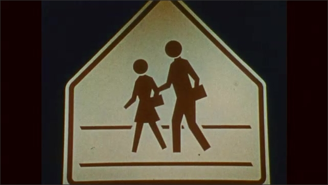 1970s: Railroad sign. Traffic light flashes. Stop sign. Pedestrian crossing sign. Traffic light sign.