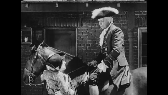 """1940s: Street.  Man rides horse.  Woman lifts and holds child.  People talk.  Door reads """"H. MASTERSON.  LAW OFFICE.""""  Man sits and reads."""
