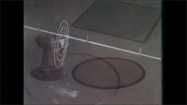 1950s: Wet shapes on chalkboard.  Circle dries.  Animation of fan blowing on circle.