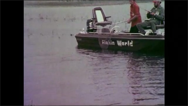 1970s: UNITED STATES: men fishing from Fishing World boat in Florida.