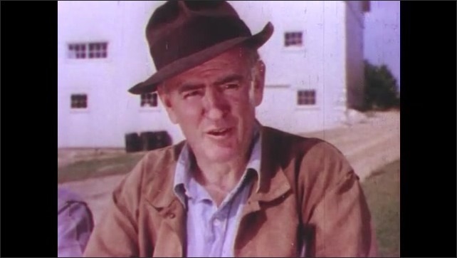 1950s: Close up of man talking.