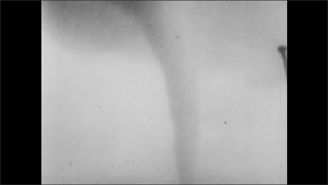 1950s: UNITED STATES: tornado crosses road. Tornado moves through town. Jury trial and on spot broadcast