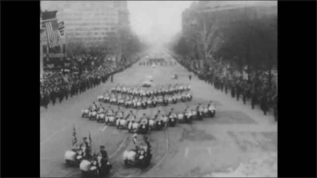 1950s: Crowds hold signs and placards in arena. Motorcycles drive in inauguration parade. President Eisenhower stands in convertible and waves to crowds.