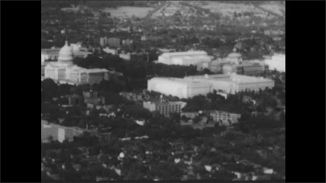 1950s: Aerial view of Washington DC. Large brick building with white pillars.