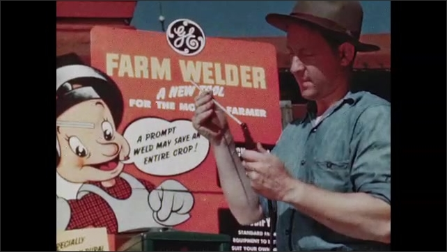 1940s: UNITED STATES: man demonstrates farm welder to farmer. Farmer looks at farm welder poster. Farmers at demonstration and clinic