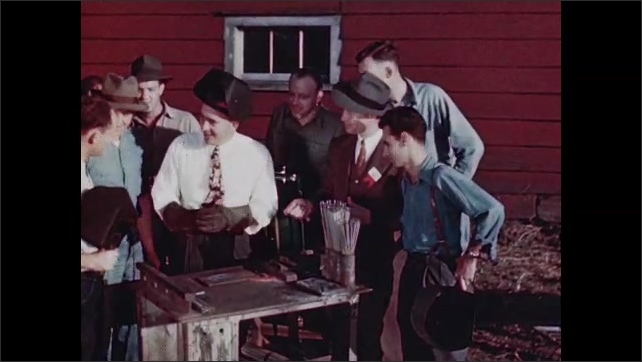 1940s: UNITED STATES: farmers try welding at clinic for first time.