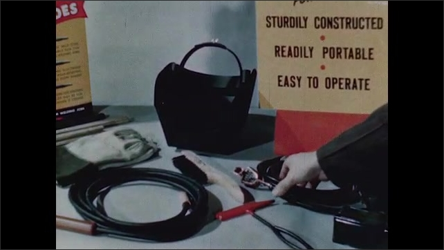 1940s: UNITED STATES: helmet for welding. Electrode holder and cable. Cable and electrodes. Wall connector. Gloves for welding.