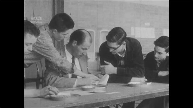 1950s: Male teacher stops to answer a student question. Students gather around a teacher to ask questions. Teacher helps with rehearsal of program after school. Teacher helps coach basketball game.