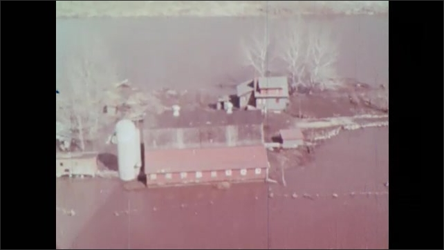 1960s: Aerial view of flooded farmland. Aerial view of dry farmland during dust storm.