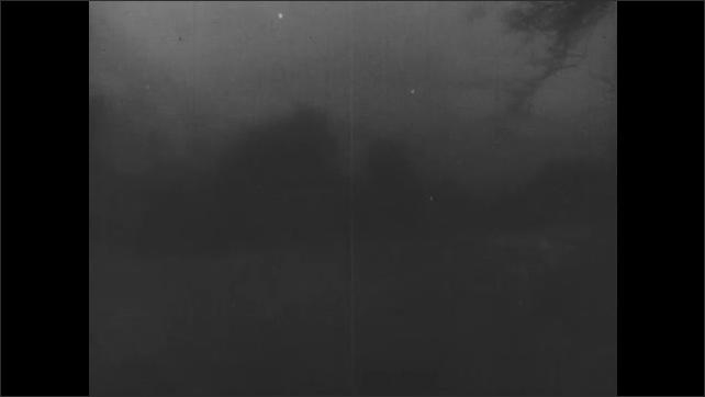 1950s: Lightning bolt. Wind and rain batter trees. Lightning bolt. Storm winds blow trees. St. Elmo