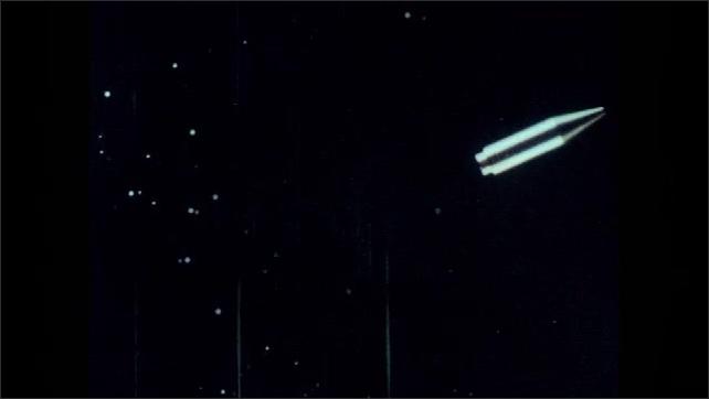 1960s: Rocket ship flies through outer space at a uniform speed.
