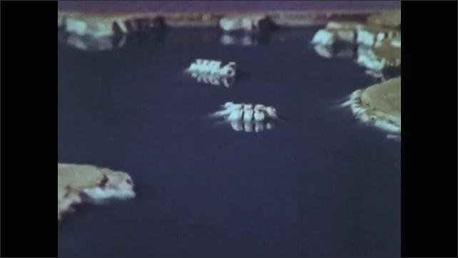 1960s: map of Atlantic Ocean floor and surrounding continents, model of ocean and continents, model of islands in water, water drains exposing more of islands