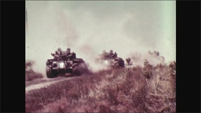 1970s: UNITED STATES: tank drives down slope.