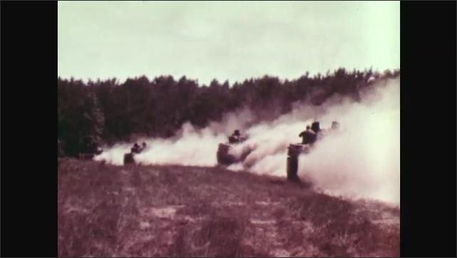 1970s: UNITED STATES: soldier fires gun. Soldier with machine gun. Tanks cross land.