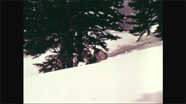 1970s: UNITED STATES: soldiers walk through snow to outpost. Soldier gestures to unit
