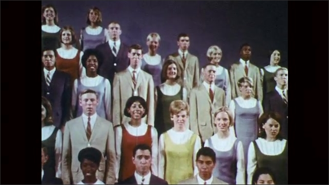 1960s: Choir of teenagers sings, boys wear suits and girls wear dresses.
