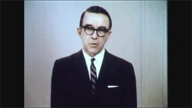 1960s: Man nods, turns to camera, talks. Man looks to the side, talks.