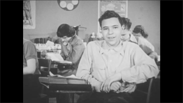 1950s: Paper with words Post Mortem Examination on it. Box of penicillin. Teenage boy in classroom talks while students around him read.