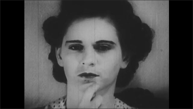 1940s: UNITED STATES: animation of germs on objects. Lady points at mouth and nose on her face.