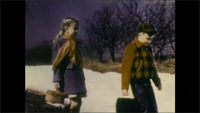 1940s: Children wave from school bus. Boy and girl run down dirt road toward snow drift and talk. Water melts from snow drift and pours onto ground.