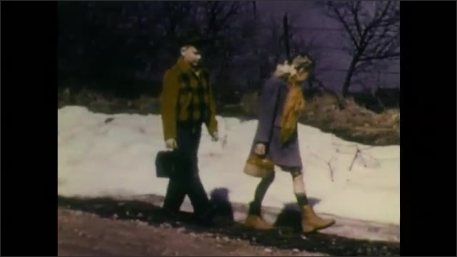 1940s: Boy and girl look down at melting snow drift. Water runs from snow drift and onto road. Boy and girl walk down road next to snow drift. Small plant amongst melting snow.