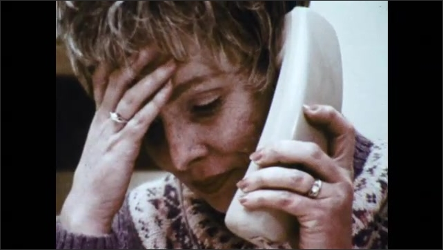 1970s: Woman with glasses speaks on the phone. Woman with short hair speaks on the phone, puts her hand on her head, looks sad and hangs up. A general sits at his desk and speaks on the phone.