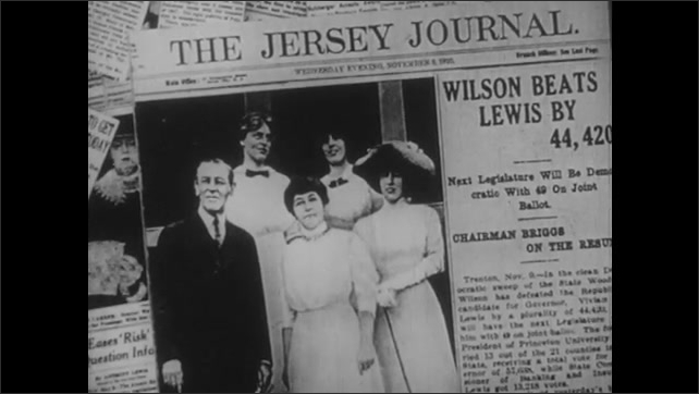 1950s: newspaper headline about Wilson defeating Lewis in election, family posing for photo