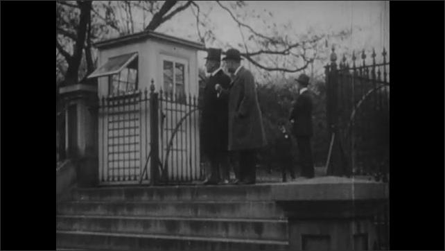 1950s: men walking out to greet celebrating crowd