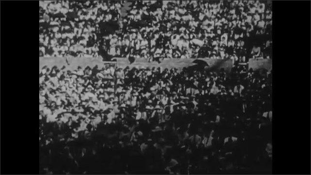 1950s: Crowd of people, President Wilson stands on stage and talks.