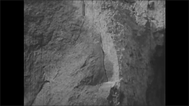 1950s: UNITED STATES: field spar rock. Clay and rock formation. Cracks in rock