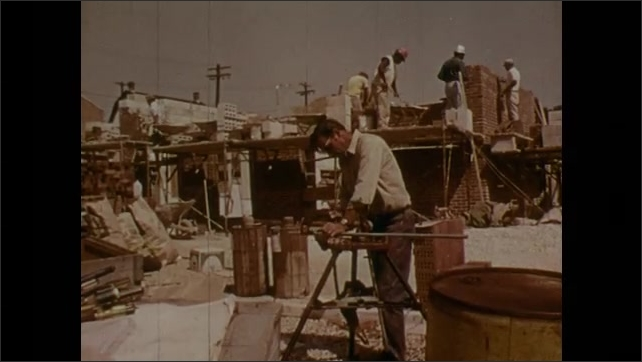 1970s: UNITED STATES: Structural work occupations stamp on paper. Bridge construction. Building of homes and businesses