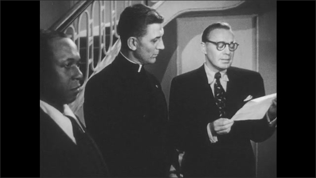 1950s: Jack Benny reads from the copy of Lincoln's Speech as Father Keller and the African-American butler listen.