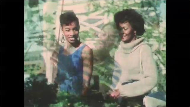 1980s: African American man swings club at golf course and golf ball rolls across course. African American women shop and chat. African American man sails on sailboat. Navy recruiter speaks.