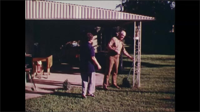 1970s: Man and woman outside on lawn, panning shots of man removing tools from doorway.