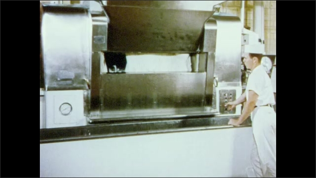 1950s: Man operates mixing machine, opens doors. Bread dough rolls around inside machine, flips out into large trough.