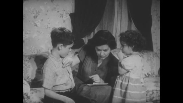 1950s: Mother talks to little girl.  Woman points to ears.  Woman mimes stethoscope on son