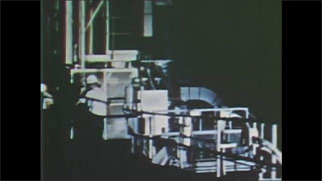 1960s: UNITED STATES: rocket on launch pad. Men walk around rocket. Rocket during launch
