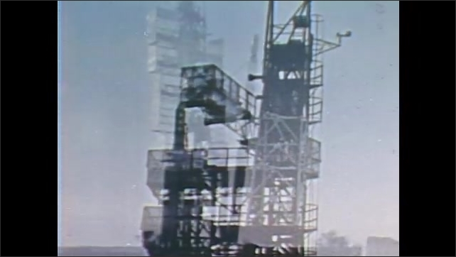 1960s: UNITED STATES: rocket launch. NASA scout launch vehicle. Booster on rocket. Men in command center. Rocket in sky