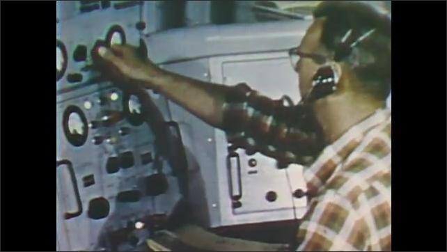 1960s: UNITED STATES: scientists follow rocket during space flight. Monitor shows echo signal of rocket