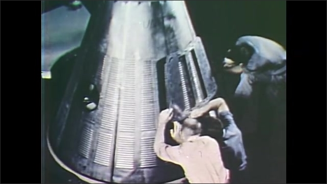 1960s: UNITED STATES: Project Mercury manned spaceflight work. Astronauts move around in space. Man instead spinning ball