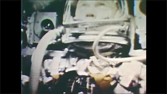 1960s: John Glenn narrates experience as the capsule separates from the rocket. Eyes and facial expressions of John Glenn in helmet.