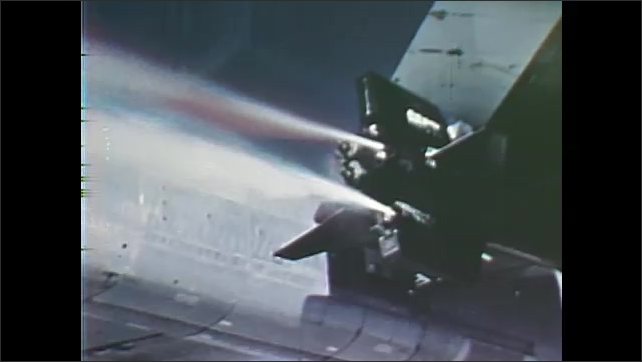 1960s: Pilot flies X-15 and his gloved hand reaches for Propellant Tanks lever. Pilot pulls lever. Jet engines thrust forward.