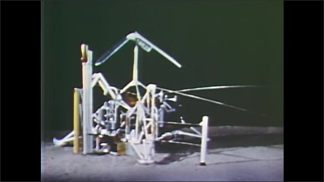 1960s: TV camera on Surveyor spacecraft model rotates and tilts. Image of moon surface.