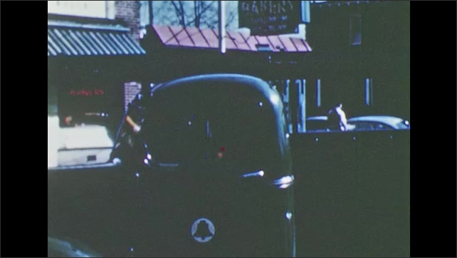 1950s: truck parallel parking, man getting in truck and looking out back to reverse