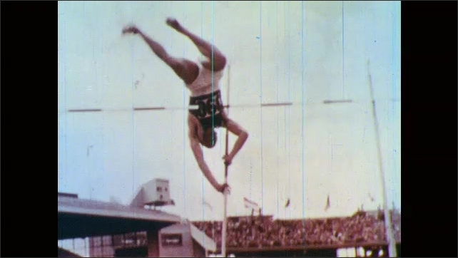 1960s: Baseball player slides into plate, player tries to tag other player. Pole vaulter runs, vaults. Man stands backwards on diving board, jumps off and spins.