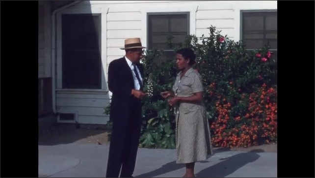 1950s San Francisco: Woman in dress walks to car and stands with man and they hand each other items. Man and woman outside Municipal Recreation Center. Woman makes sure door is locked.