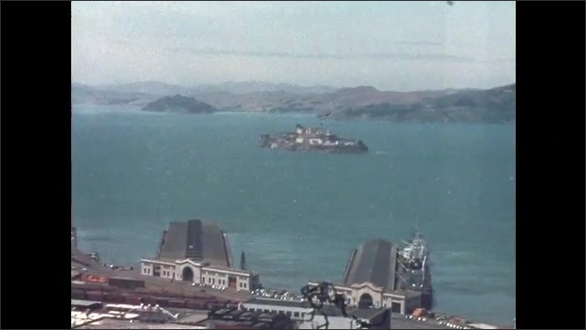 1950s San Francisco: Coit Tower from base on Telegraph Hill. View of Alcatraz and the San Francisco neighborhoods from Coit Hill.