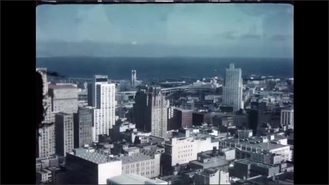 1960s: San Francisco bay and harbor. Bay Bridge. Downtown San Francisco.