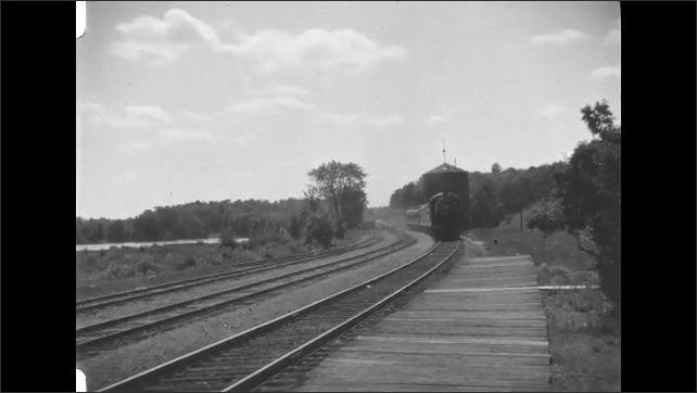 1930s: Train travels down tracks.